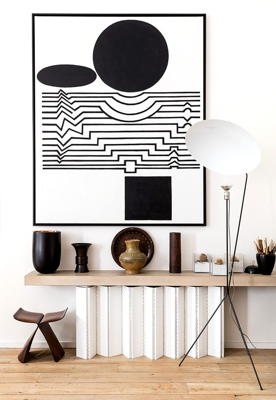 The designer opted for light-colored wooden floors, white walls to create a great backdrop for his art collections, which added character to the spaces