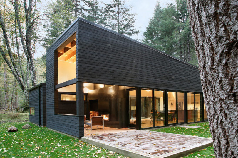 The exterior is clad with Western red cedar with a dark finish, there are a lot of windows and skylights