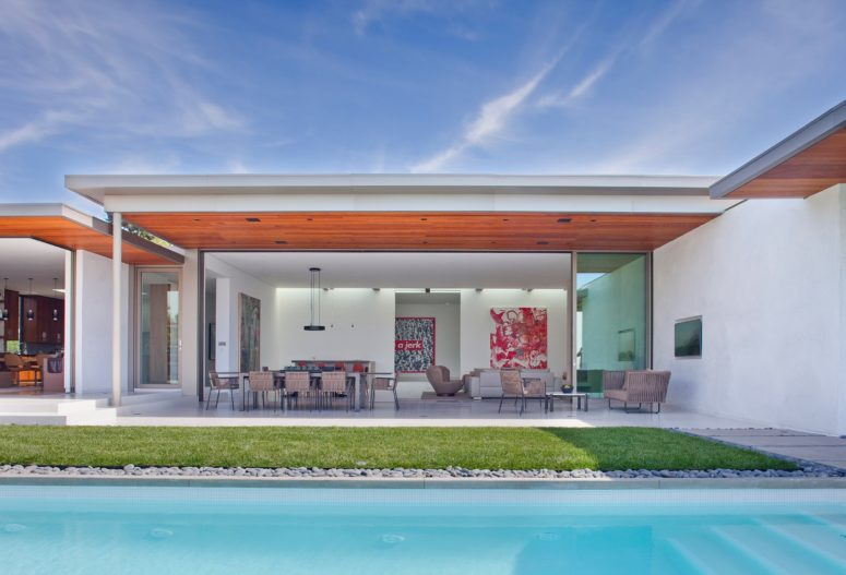 The house consists of several wings, all of them can be easily opened to outdoors, there's an inner courtyard and a swimming pool