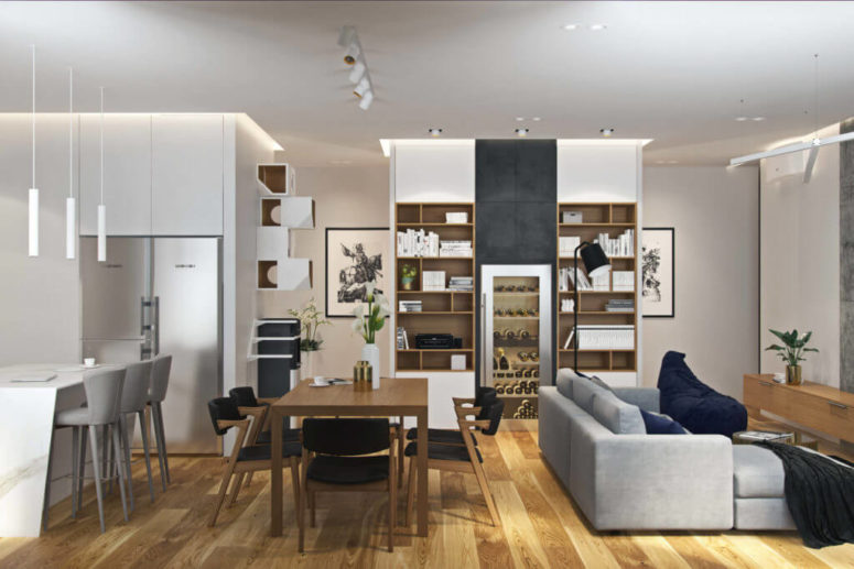 The living room, dining room and the kitchen are united into one big open layout, with a wide use of nautral wood and different shades of grey