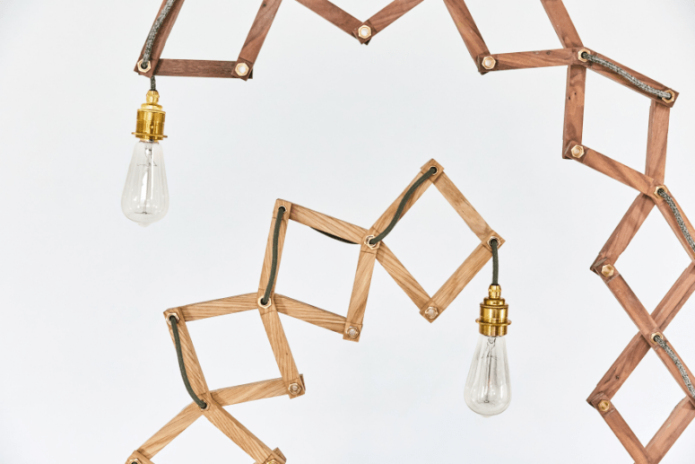 The scissor sctructure is made of wood, and is crowned with a cute bulb - nothing excessive is here
