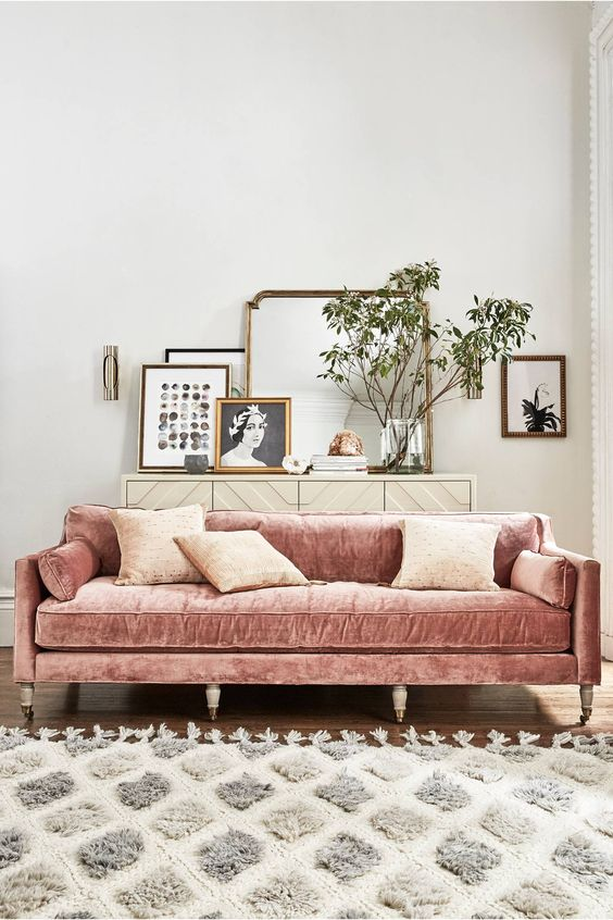 a blush velvet sofa will enliven a neutral living room and make it more feminine