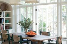 02 a coastal dining room with a rough wooden trestle dining table that adds texture and style