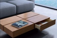 02 a coffee table that features four drawers for storage and a cool laconic look