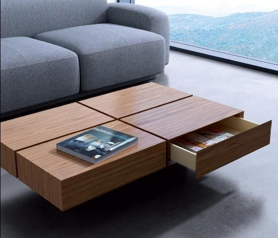 a coffee table that features four drawers for storage and a cool laconic look