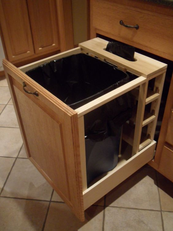 a large pull out drawer with a trash can is ideal for any kitchen, choose the most comfortable one