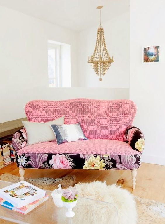 a loveseat with mixed upholstery in geo pink and large blooms in the black backdrop adds a glam touch
