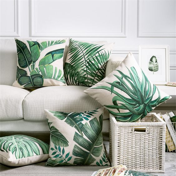 a selection of torpical leaf print pillows is a budget-savvy way to brighten up the space