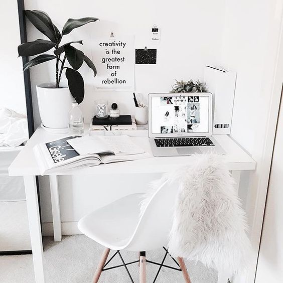 this white Nordic home office was made more interesting with a faux fur chair cover