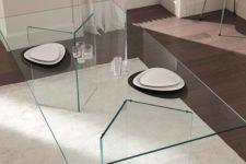 02 ultra-minimalist dining table with geo glass legs and a glass tabletop, the dishes seem to be floating in the air