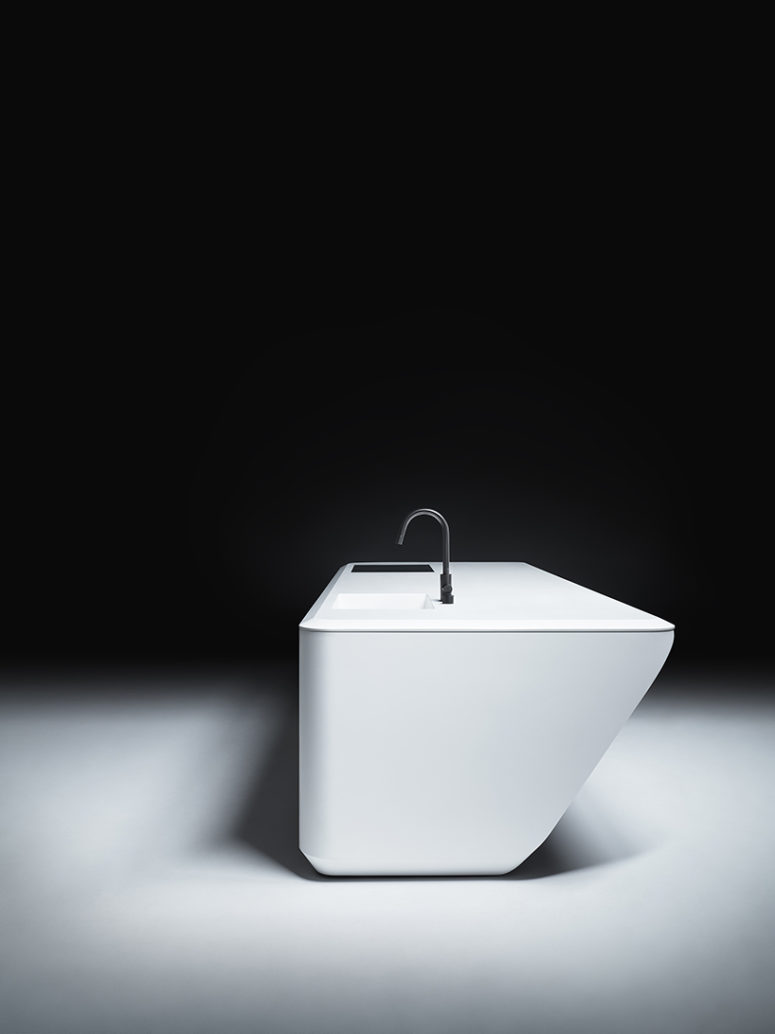 There's an embedded sink and a sleek surface available in many materials and finishes