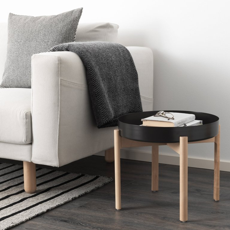 These are two key pieces of Ypperlig collection, a sofa and a wooden stand side table