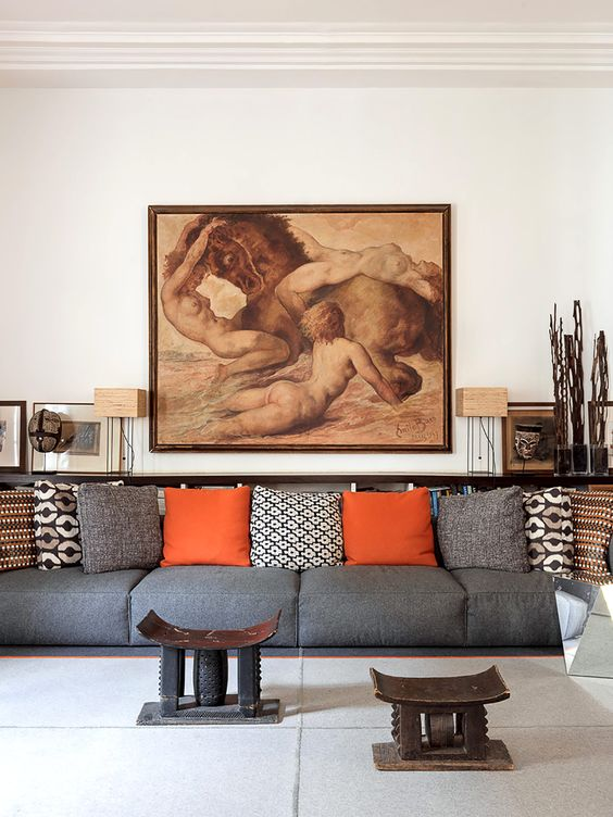 This is the second living room with an oversized grey sofa, Asia-inspired artworks and furniture and a bold piece of art that makes a statement