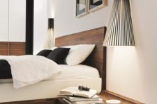 03 a floating wooden nightstand attached to the bed frame and in a matching shade