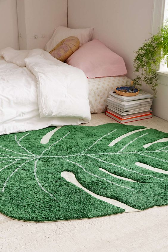 a monstera leaf rug won't cost much but will add a cool cheery feel