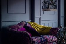 03 if your space is moody and dark, why not go for a deep purple and blue loveseat that fits the style