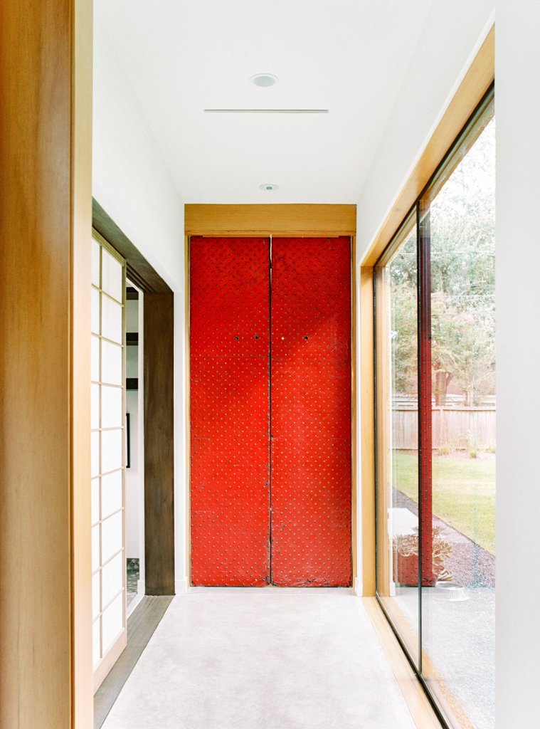 The entrance is traditionally red, it resembles the doors of a Japanese temple