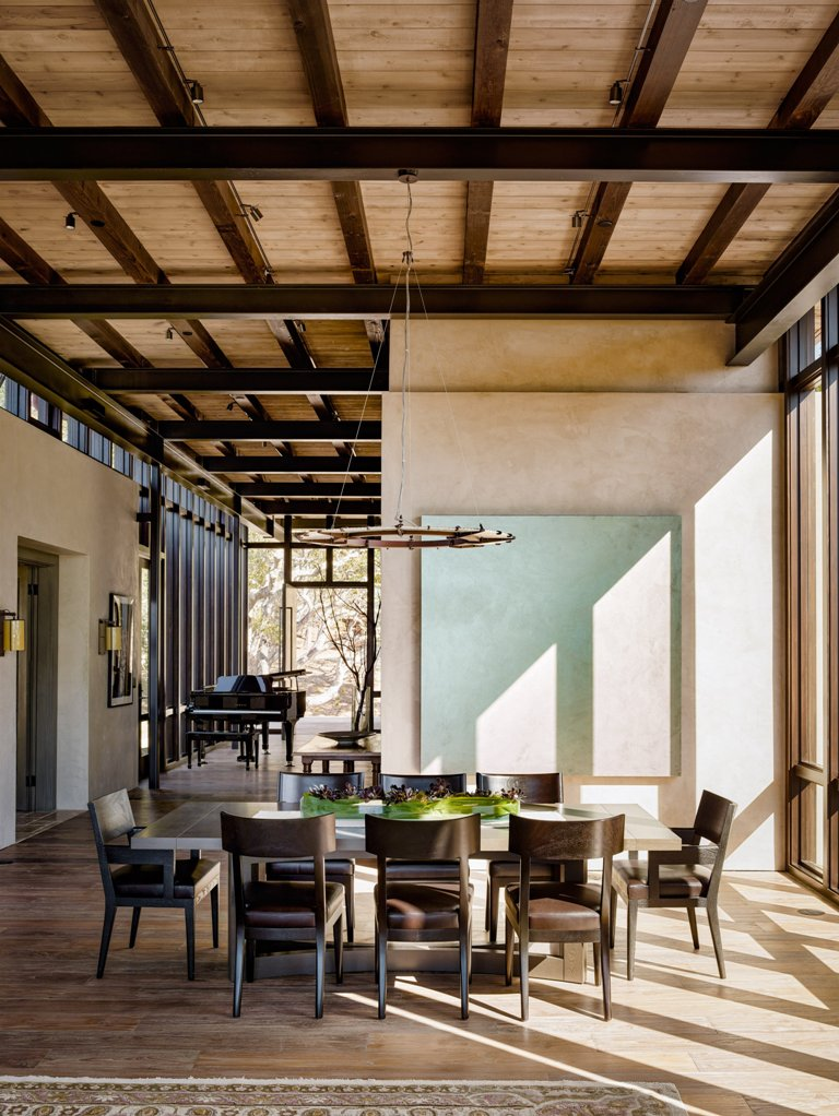 The inner space was done with a cozy warm color palette, beige, brown, cream and mint, there are dark wooden beams on the ceiling