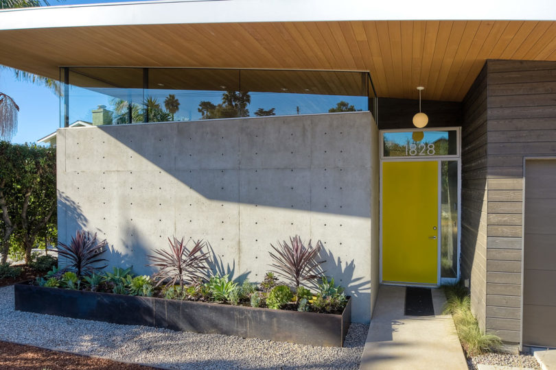 The outdoor spaces are hardscaped with pebbles and there are boxes with succulents and cacti