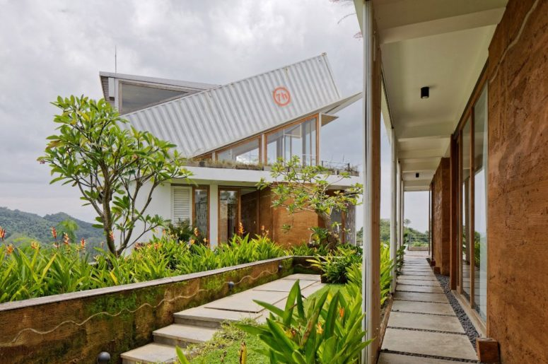 There's much greenery and flowers outside as the house is located in one of the islands east of Bali