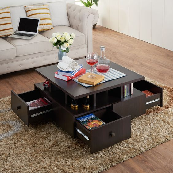 a coffee table with open shelving and drawers will save much space