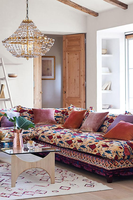 A Colorful Sectional Sofa With Bold Velvet Pillows For Lively Boho Chic E