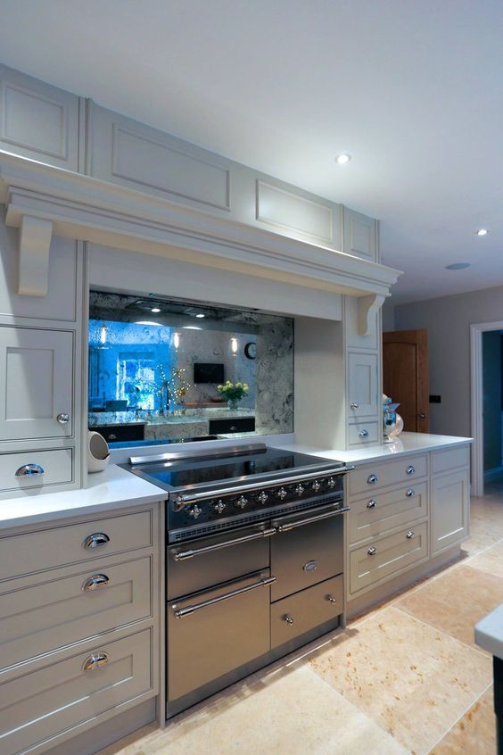 a stylish antique mirror backsplash behind the cooker