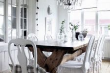 04 a white shabby chic dining space with a wooden trestle table