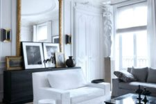 04 an antique French framed mirror adds chic and beauty to this living room
