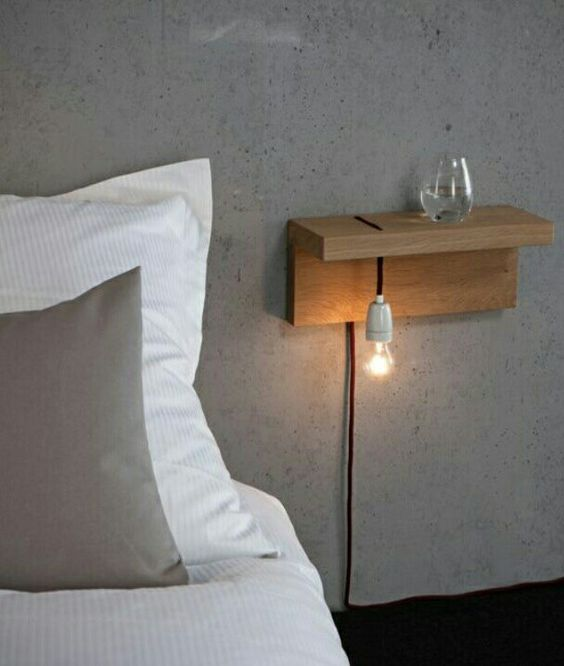 attach a piece of wood to the wall and add a bulb - and voila, an industrial nightstand is ready