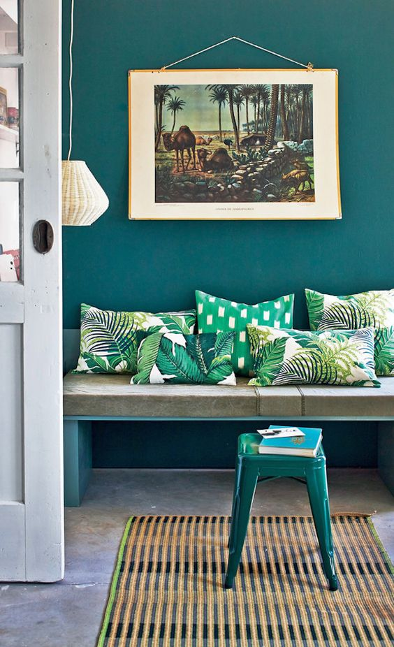 colorful tropical leaf print pillows will spruce up your entryway and make it bold