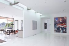 05 The interior spaces are done in white to feature a perfect backdrop for the owner's art collection and a simple material palette is characteristic of modernist style