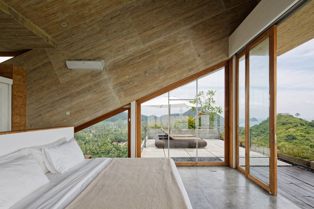 The master bedroom is very minimalist and is focused around the gorgeous views, almost all the walls are glazed