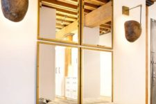 05 a combo of four same mirrors for the entryway looks chic, modern and welcoming