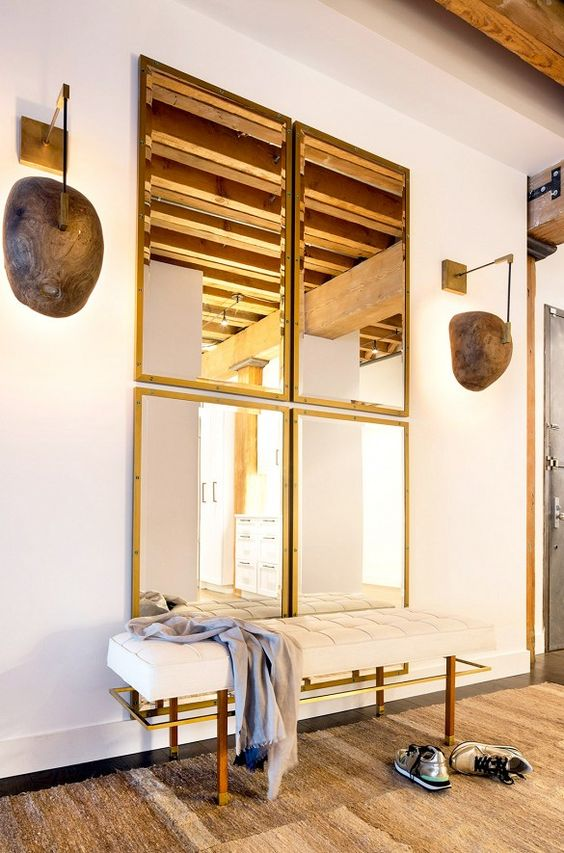 a combo of four same mirrors for the entryway looks chic, modern and welcoming