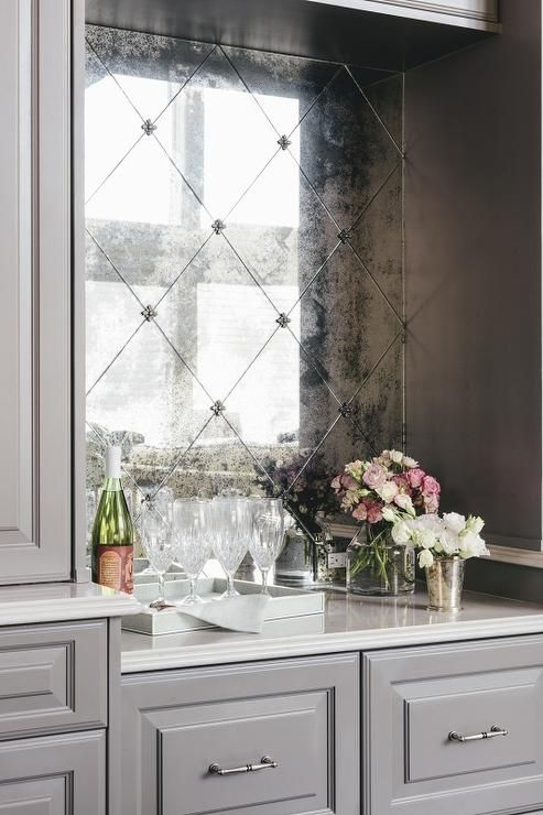 an antique mirror bar backsplash fits grey and white cabinets perfectly