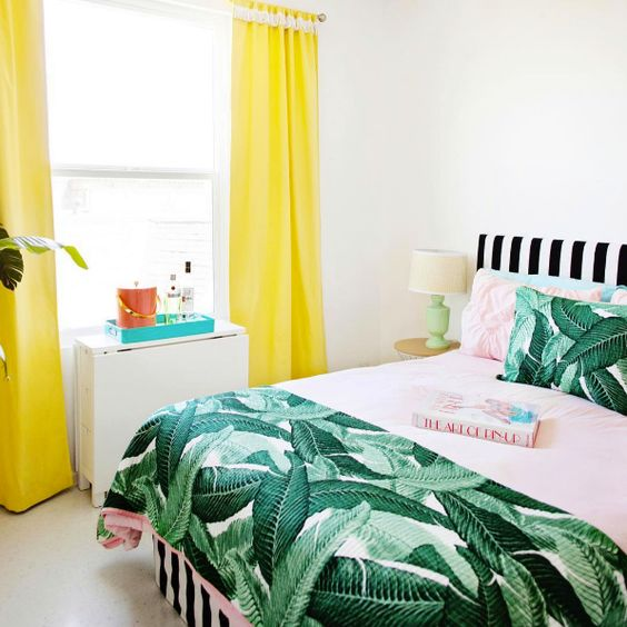 bright colors plus a vintage banana leaf print bedspread and pillows for a playful summer bedroom