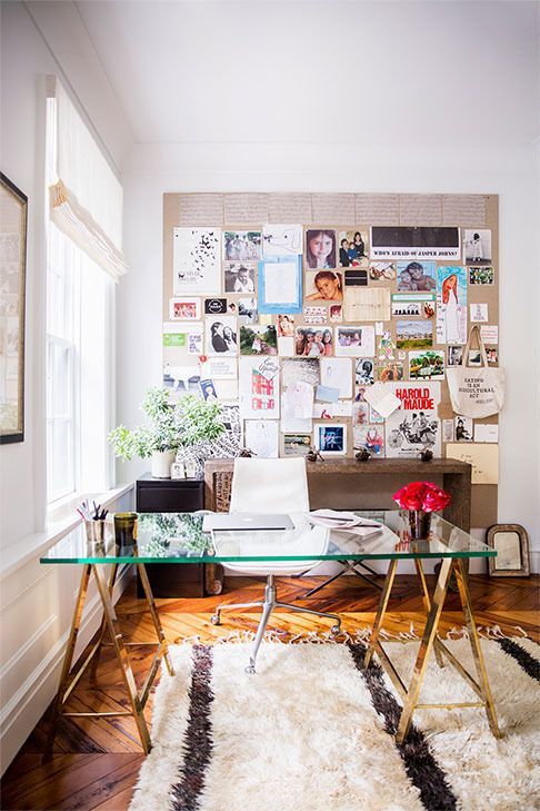 modern feminine home office with a glass desk with metal trestle legs