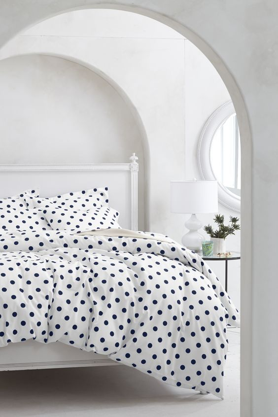 white and navy polka dot bedding for a girl's space