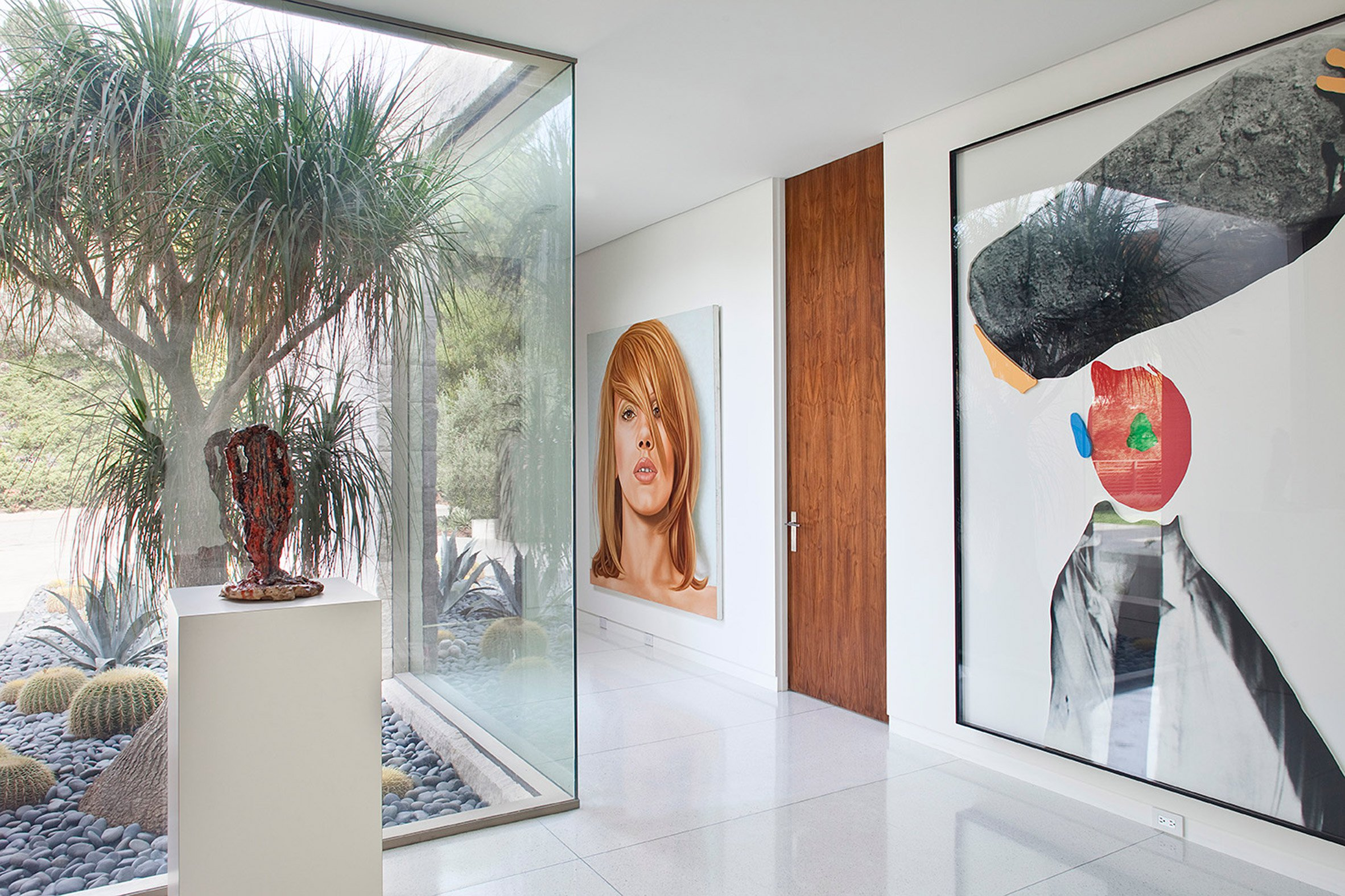 The entrance features a long gallery where the large scale art works are placed, and the rest of the house is built around this space