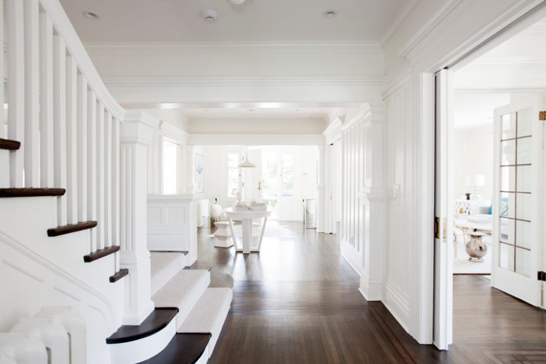 The interiors are white but dark stained floors make them contrasting and give a character