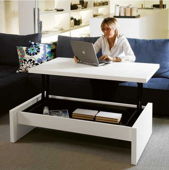 a coffee table becomes a desk - no need for a home office