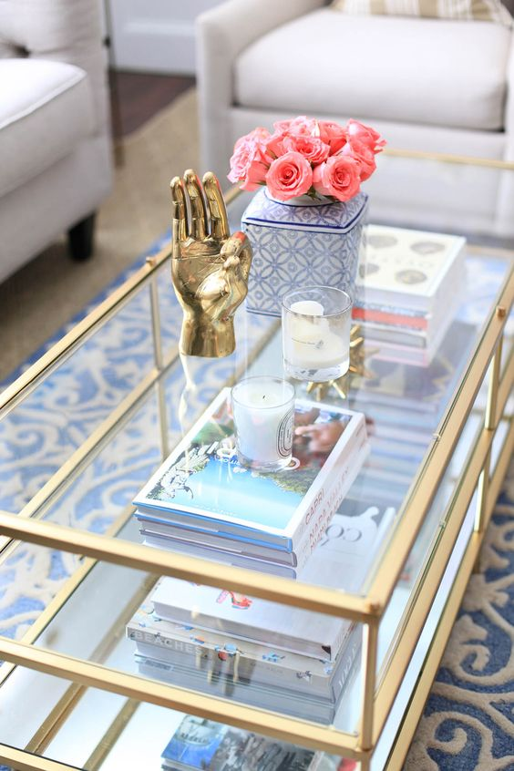 Merveilleux A Glass Three Tiered Coffee Table With Gilded Framing Offers Storage And  Looks Chic And