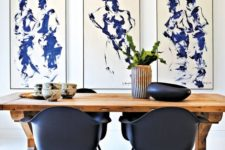 06 a gorgeous modern dining space with a trestle wooden table and black chairs
