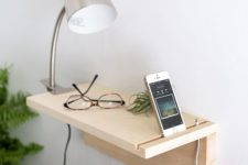 06 a minimalist wooden plank floating nightstand for holding just a couple of things and charging your phone