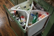 06 a pull out drawer with separate trash cans is a comfortable idea