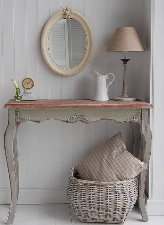 a tiny antique desk as an entrance table for a rustic vintage space