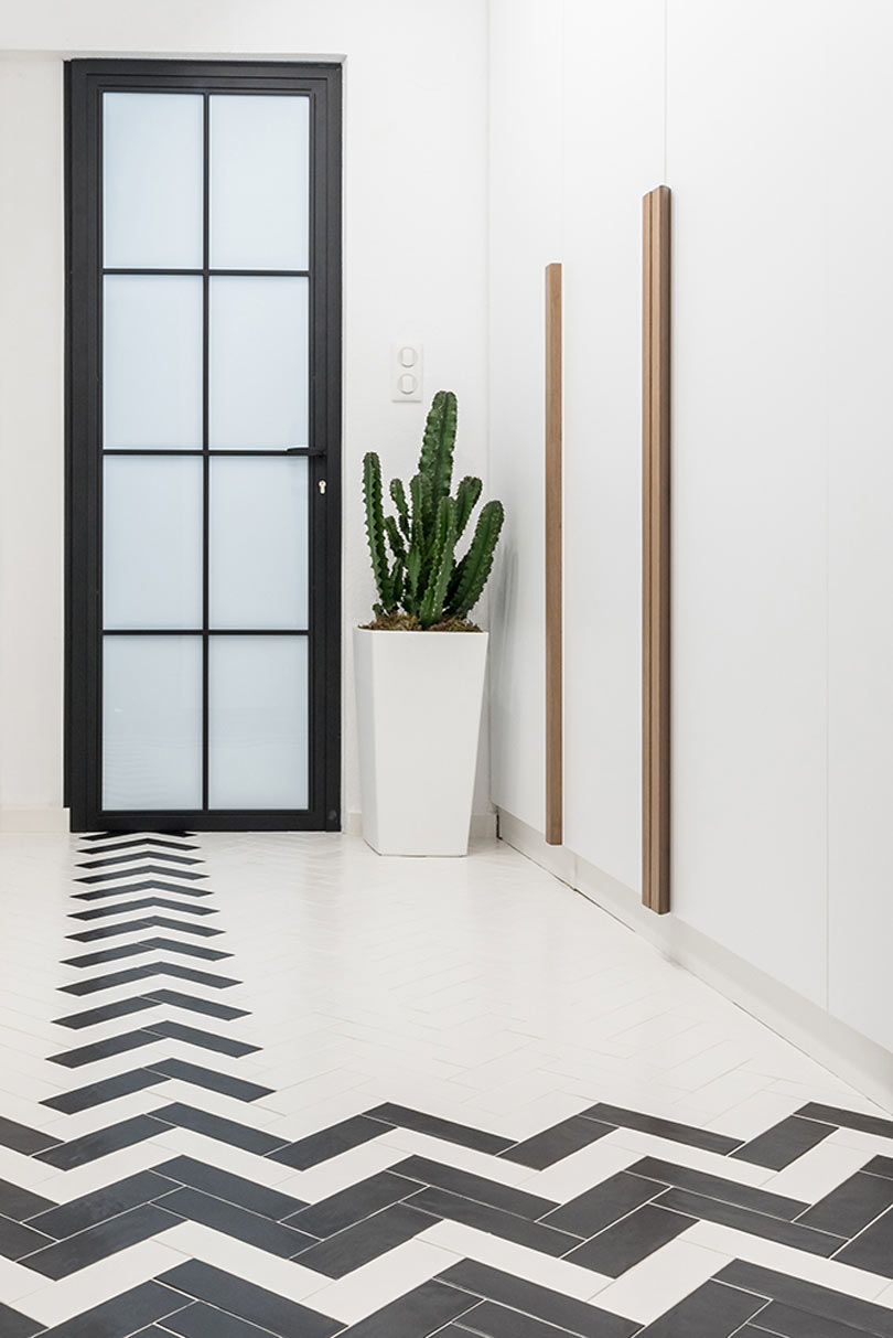 The floors upstairs are clad with tiles in a herringbone pattern, and there are a lot of wardrobes for storage