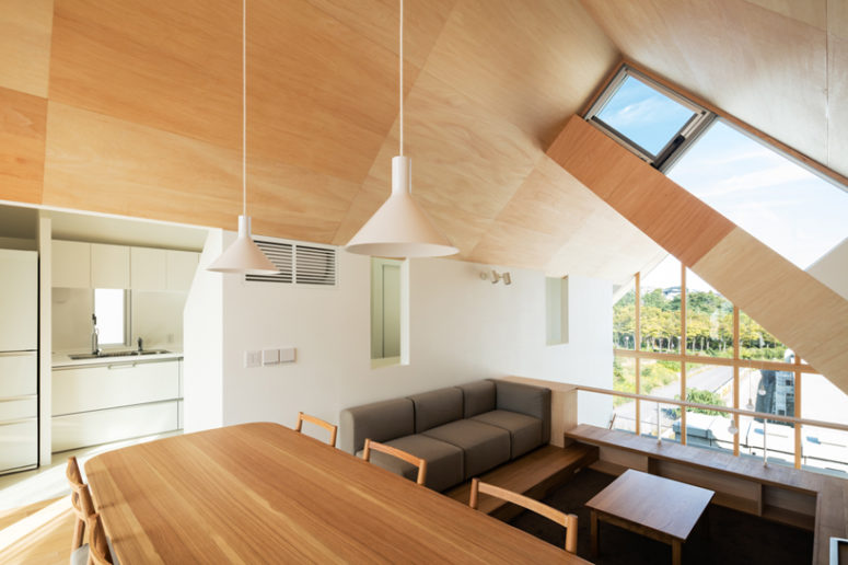 Wood clad minimalist house with three spaces digsdigs for Living room upstairs