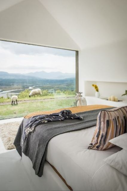The master bedroom features a panoramic window with amazing and relaxing views including lake views